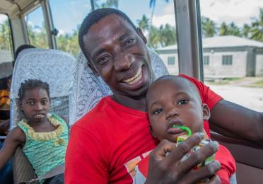 Mussa Abdala and his family on the bus