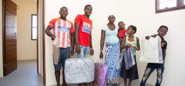 The Abdala family receiving a 3-month food basket and welcome pack